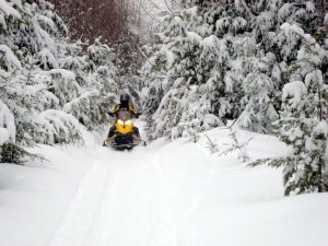 Trail to Rainbow Lake snowmobiling near Millinocket, Maine - photo: Richard Levasseur