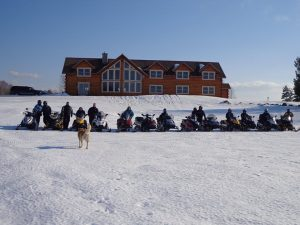 Happy Snowmobilers at 5 Lakes Lodge near Millinocket, Maine - photo: Richard Levasseur